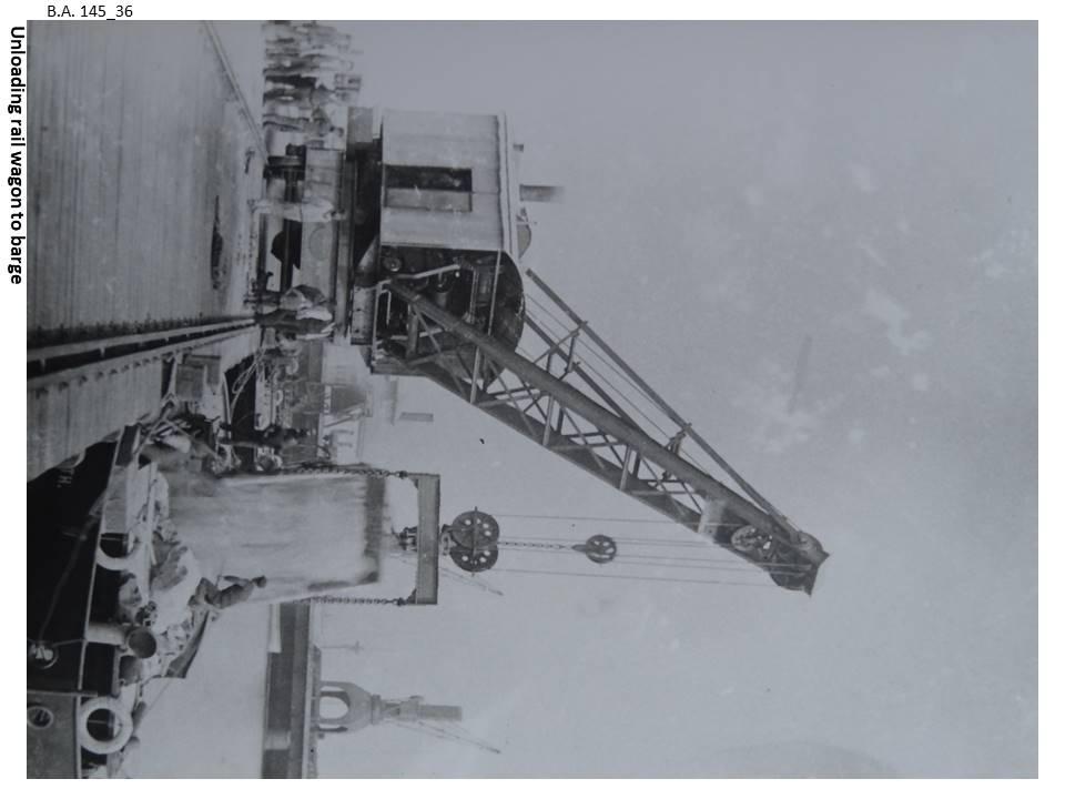 145_36-Unloading_rail_wagon_to_barge