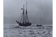 Wooden_sailing_ship_ashore_at_Chesil_Cove